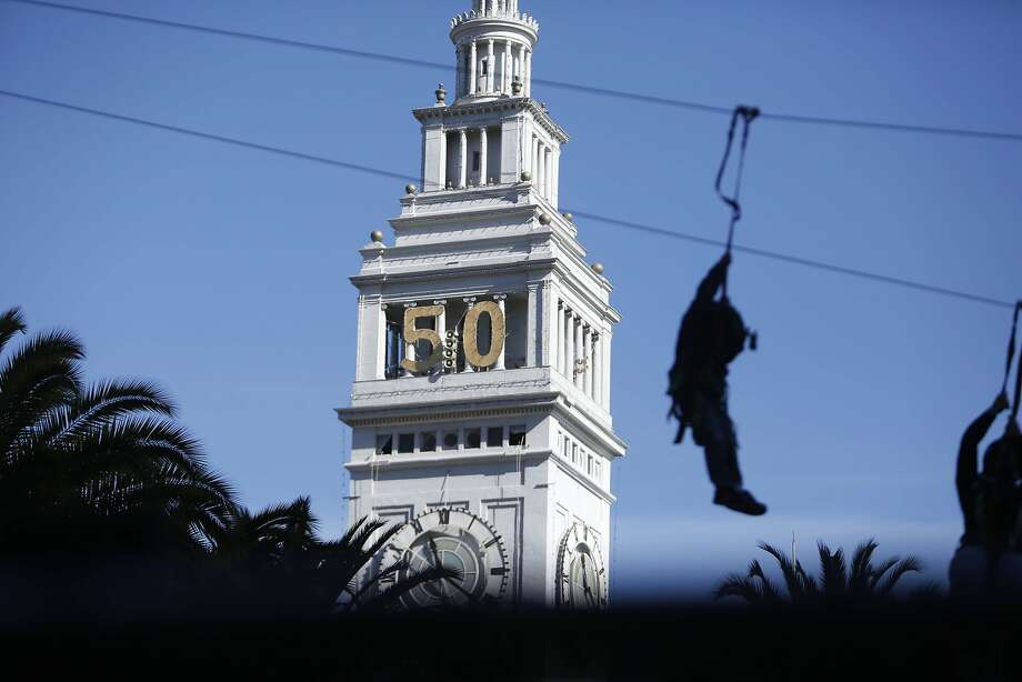 A visitor to Super Bowl City goes down a zip line as the Ferry Building is seen in the background at Super Bowl City on Sunday, February 7, 2016 in San Francisco, Calif. Photo: Lea Suzuki, The Chronicle