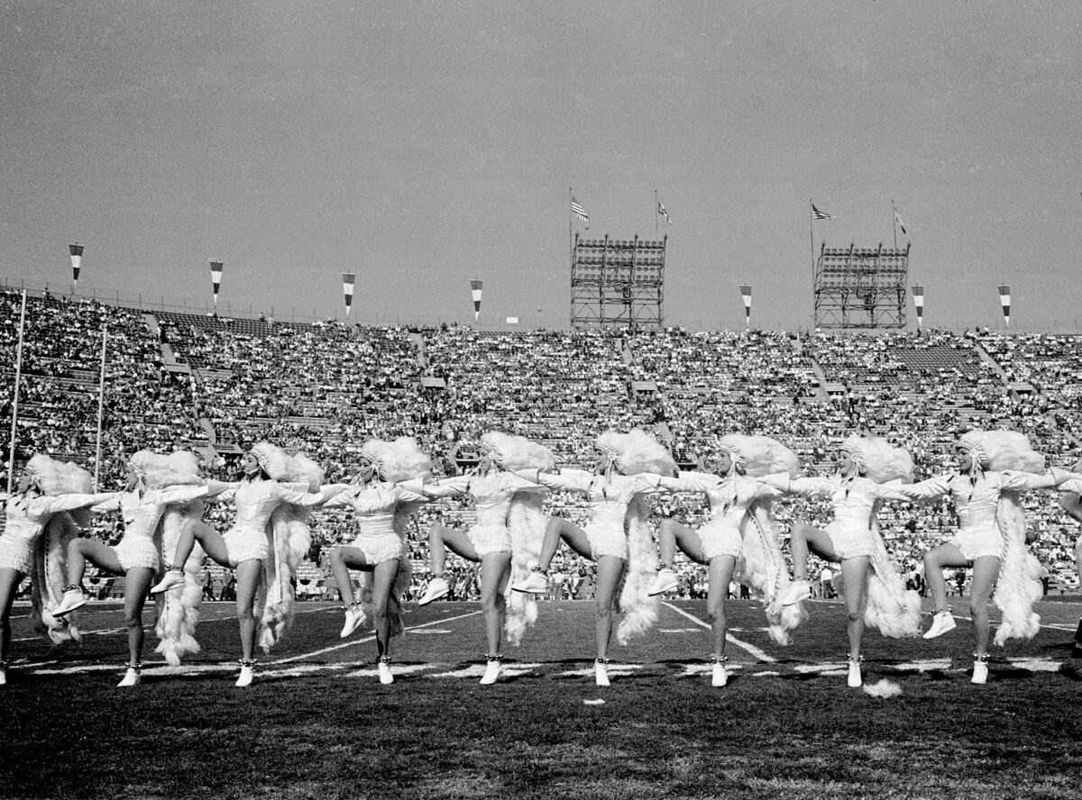 LOS ANGELES - JANUARY 15: The First World Championship Game, AFL vs. NFL, later known as Super Bowl I, on January 15, 1967 at the Los Angeles Memorial Coliseum in Los Angeles, California. Cheerleaders in glamorized American Indian costumes.