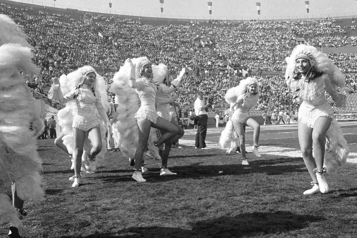 LOS ANGELES - JANUARY 15: The First World Championship Game, AFL vs. NFL, later known as Super Bowl I, on January 15, 1967 at the Los Angeles Memorial Coliseum in Los Angeles, California. Cheerleaders in glamorized Indian costumes.