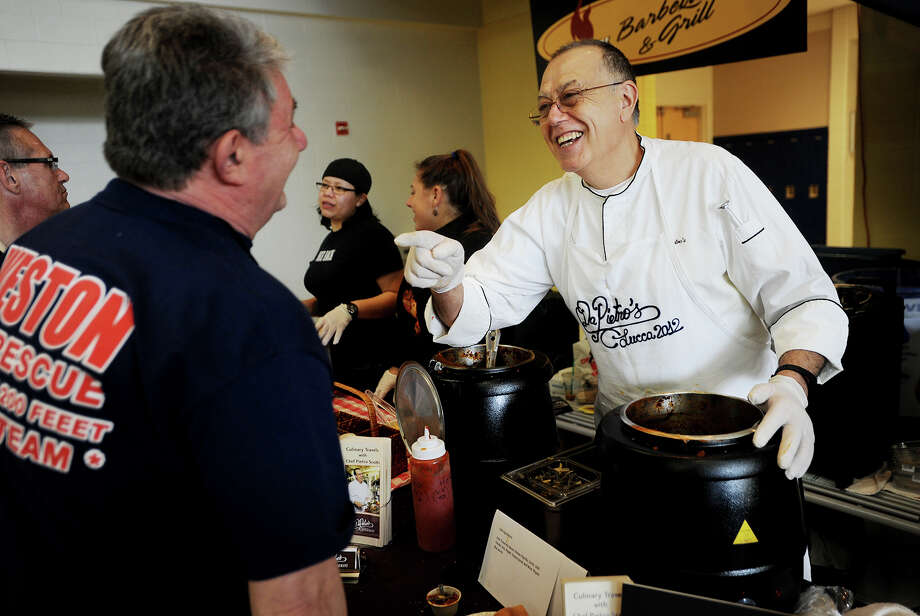 Competitors Frank Caolo, left, of the Weston Volunteer Fire Department, and Chef Pietro Scotti, of DaPietro's Restaurant in Westport, indulge in some friendly trash talk during the 2016 MacChilifest pre-Super Bowl event at Bedford Middle School in Westport, Conn. on Sunday, February 7, 2016. Attendees were able to indulge in twenty different chili and macaroni entries and vote for their favorites. Photo: Brian A. Pounds, Hearst Connecticut Media / Connecticut Post