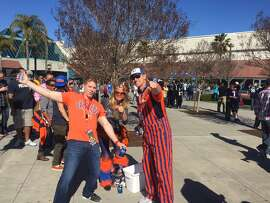 Broncos fans wearing funky threads.
