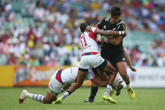 SYDNEY, AUSTRALIA - FEBRUARY 07:  Ben Lam of New Zealand is tackled during the 2016 Sydney Sevens cup quarter final match between New Zealand and the United States of America at Allianz Stadium on February 7, 2016 in Sydney, Australia.  (Photo by Mark Kolbe/Getty Images)