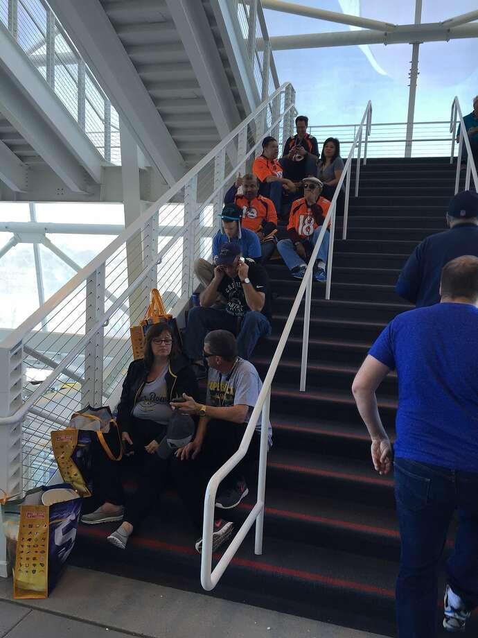 Super Bowl fans found a stairwell to escape the pregame heat at Levi's Stadium. Photo: Ron Kroichick