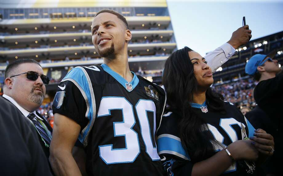 Stephen and Ayesha Curry are seen on the sideline before Super Bowl 50 between the Carolina Panthers and the Denver Broncos at Levi's Stadium on Sunday, Feb. 7, 2016 in Santa Clara, Calif. Photo: Scott Strazzante, The Chronicle