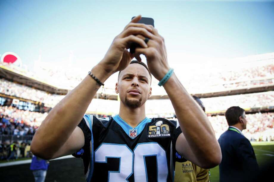 Stephen Curry takes a photo before Super Bowl 50 between the Carolina Panthers and the Denver Broncos at Levi's Stadium on Sunday, Feb. 7, 2016 in Santa Clara, Calif. Photo: Scott Strazzante, The Chronicle / ONLINE_YES