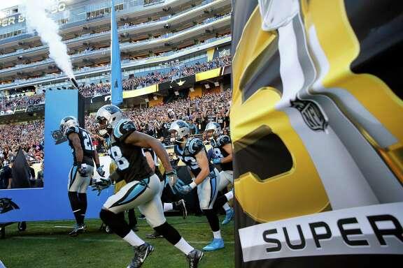 The Carolina Panthers take the field to play the NFL Super Bowl 50 football game against the Denver Broncos, Sunday, Feb. 7, 2016, in Santa Clara, Calif. (AP Photo/Matt York)