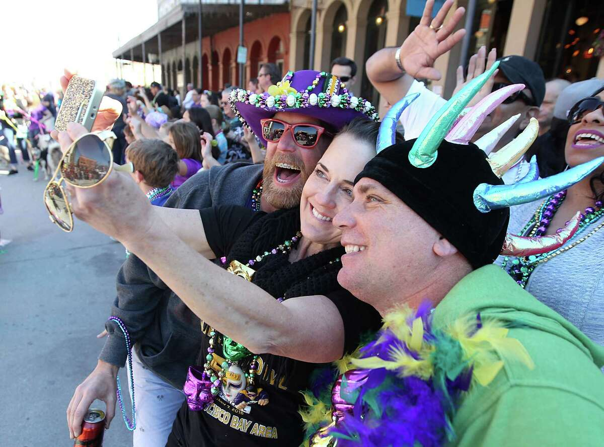 Friends take a selfie on Sunday , February 7, 2016 in the Barkus Parade on the Strand in Galveston, Texas.