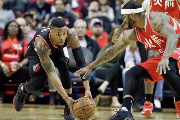 """We are just a step slow on everything,"" James Harden says of the Rockets, a point Josh Smith, right, confirms in this pursuit of a loose ball with the Trail Blazers' Damian Lillard during Saturday's loss."