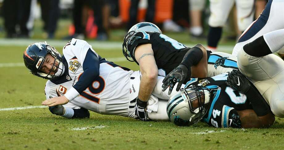 Denver Bronco Peyton Manning is tackled during Super Bowl 50 against the Carolina Panthers at Levi's Stadium in Santa Clara, California, on February 7, 2016. Photo: Timothy A. Clary, AFP / Getty Images