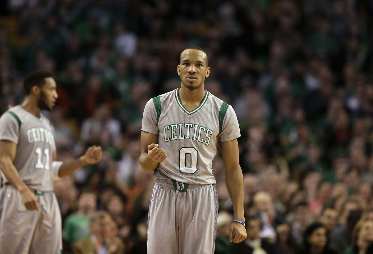 Boston Celtics guard Avery Bradley (0) and guard Evan Turner (11) react after their team scored against the Sacramento Kings in the fourth quarter of an NBA basketball game, Sunday, Feb. 7, 2016, in Boston. (AP Photo/Steven Senne)
