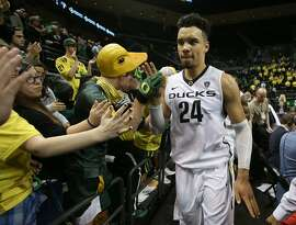 Oregon's Dillon Brooks high-fives Duck fans after his team defeated Utah in an NCAA college basketball game Sunday, Feb. 7, 2016, in Eugene, Ore. (AP Photo/Chris Pietsch)