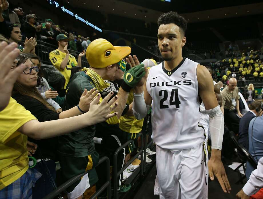 Oregon's Dillon Brooks high-fives Duck fans after his team defeated Utah in an NCAA college basketball game Sunday, Feb. 7, 2016, in Eugene, Ore. (AP Photo/Chris Pietsch) Photo: Chris Pietsch, Associated Press
