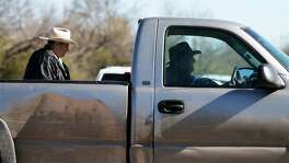 A Uvalde County Sheriffs Deputy lets a resident pass as he guards the intersection to a neighborhood several miles outside of Uvalde after a standoff resulted in multiple deaths on Saturday, Feb. 6, 2016. The incident started around 5 p.m. on Friday. Officials have not given an official account about the circumstances surrounding the standoff.  (Kin Man Hui/San Antonio Express-News)