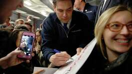 Republican presidential candidate Marco Rubio autographs a sign during a Super Bowl watch party at Ultimate Sports Academy, February 7, 2016, in Manchester, New Hampshire. Marco Rubio, the young Republican senator fast building momentum in the race for the White House, came back swinging after a mauling in the latest presidential debate for his lack of experience. / AFP / DOMINICK REUTERDOMINICK REUTER/AFP/Getty Images