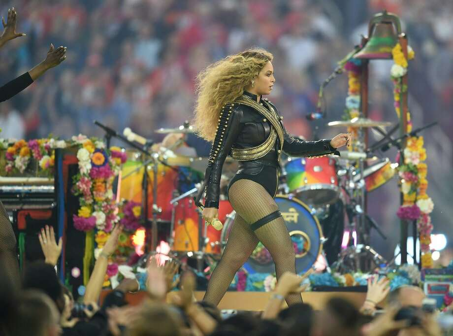 Beyonce takes command of the stage wearing a militaristic Dsquared2 jacket over her leotard and fishnets. Photo: Timothy A. Clary, AFP / Getty Images