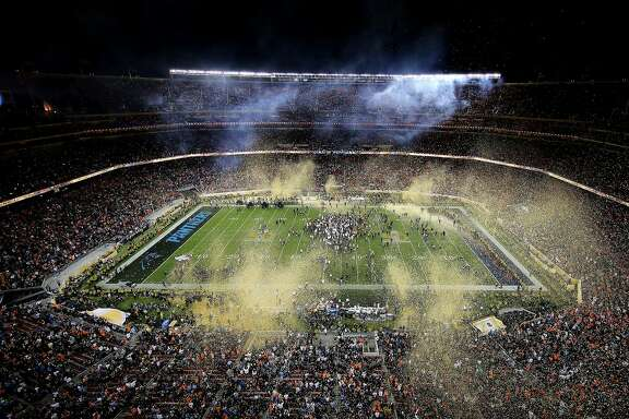 SANTA CLARA, CA - FEBRUARY 07:  Confetti falls as the Denver Broncos celebrate defeating the Carolina Panthers 24-10 in Super Bowl 50 at Levi's Stadium on February 7, 2016 in Santa Clara, California.  (Photo by Ezra Shaw/Getty Images)