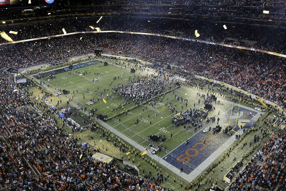 Confetti covers the field after the NFL Super Bowl 50 football game Sunday, Feb. 7, 2016, in Santa Clara, Calif. The Broncos won 24-10. (AP Photo/Morry Gash) Photo: Morry Gash, Associated Press