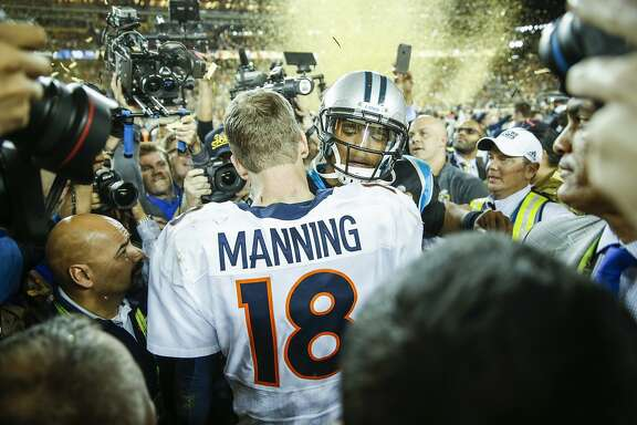 Denver Broncos' Peyton Manning and Carolina Panthers' Cam Newton meet after the Denver Broncos defeated the Carolina Panthers 24 to 10 in Super Bowl 50 at Levi's Stadium on Sunday, Feb. 7, 2016 in Santa Clara, Calif.