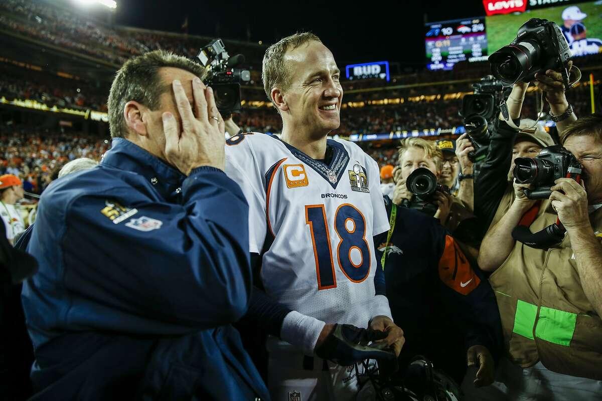 Denver Broncos' Peyton Manning andHead Coach Gary Kubiak celebrate after winning Super Bowl 50 between the Carolina Panthers and the Denver Broncos at Levi's Stadium on Sunday, Feb. 7, 2016 in Santa Clara, Calif.