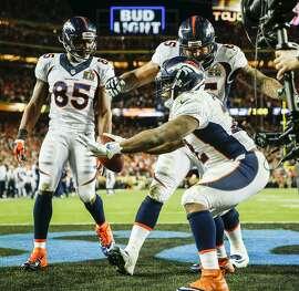 Denver Broncos' C.J. Anderson celebrates a fourth quarter touchdown during Super Bowl 50 between the Carolina Panthers and the Denver Broncos at Levi's Stadium on Sunday, Feb. 7, 2016 in Santa Clara, Calif.