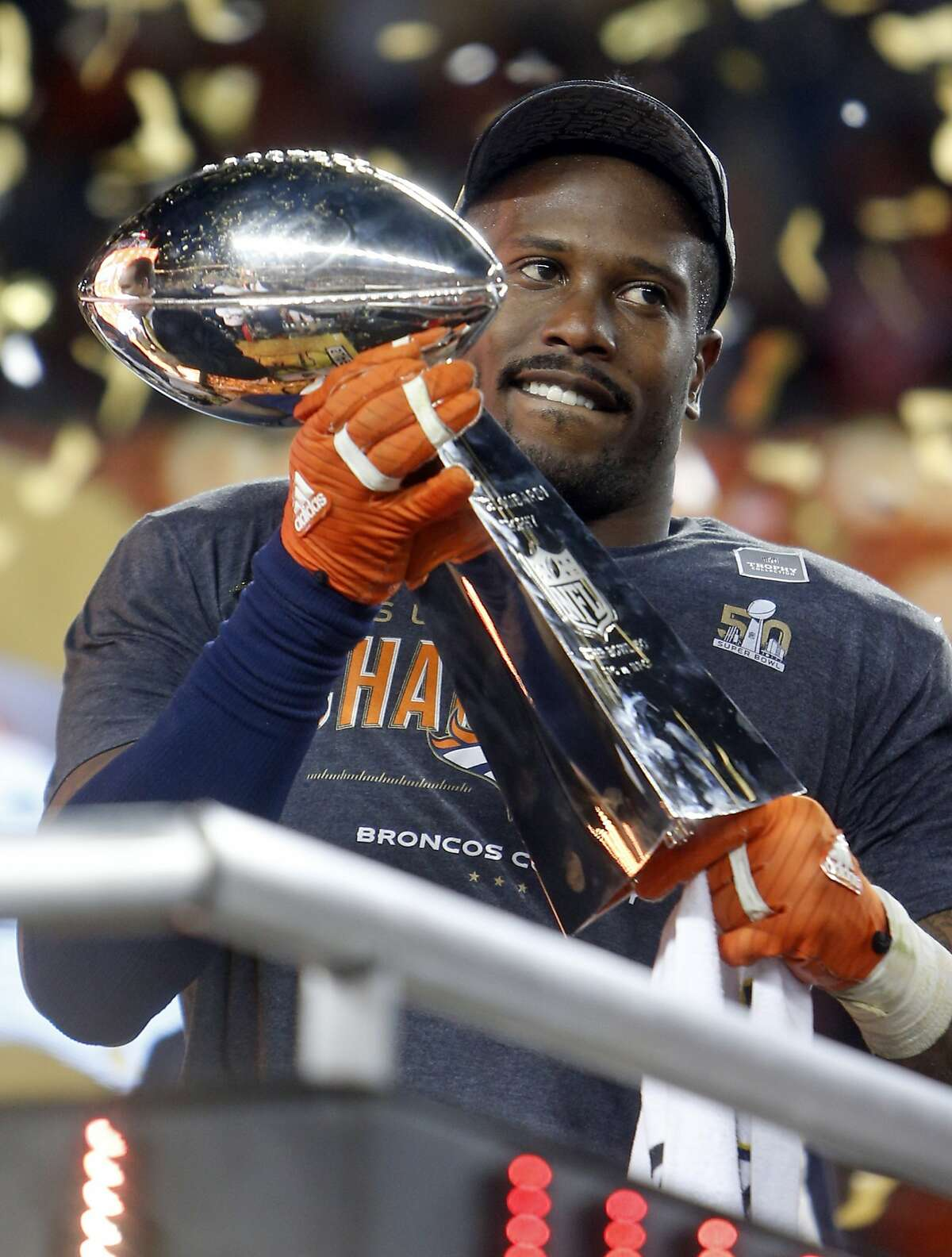 Super Bowl MVP Denver Broncos' Von Miller with Vince Lombardi trophy after 24-10 win over Carolina Panthers during Super Bowl 50 at Levi's Stadium in Santa Clara, Calif., on Sunday, February 7, 2016.