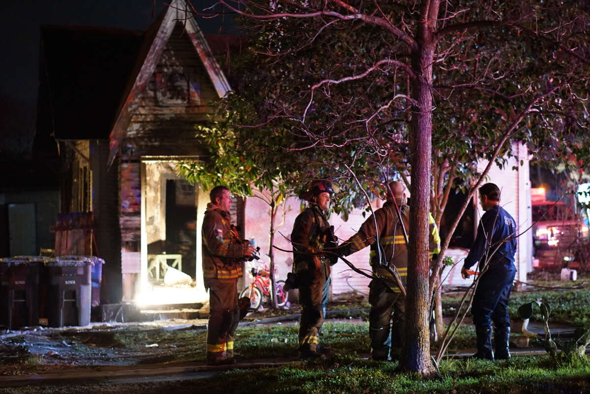 Neighbors rescued children from a house fire Sunday, Feb. 7, 2016, who were apparently home alone when the blaze started at a home in the 2300 block of North Navidad Street.