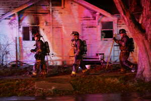 Four children rescued from a house fire by neighbors on the West Side - Photo