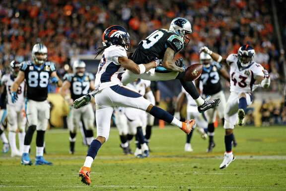 The Broncos' Bradley Roby makes sure Ted Ginn Jr. fails to hold on to a pass in the second half.