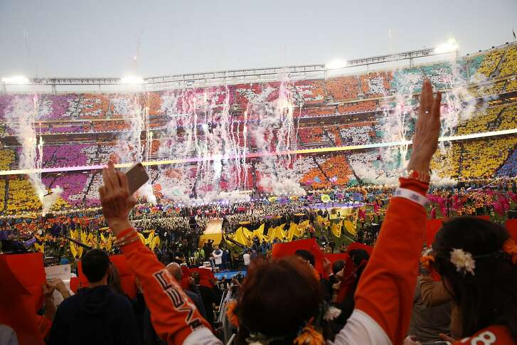 Fans cheer during the half time show at  Super Bowl 50 at Levi's Stadium, Sunday, February 7, 2016 in Santa Clara, Calif.