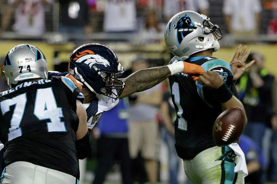 Denver Broncos' Von Miller (58) strips the ball from Carolina Panthers' Cam Newton (1) during the second half of the NFL Super Bowl 50 football game Sunday, Feb. 7, 2016, in Santa Clara, Calif. (AP Photo/Marcio Jose Sanchez)  ORG XMIT: NFL536 Photo: Marcio Jose Sanchez / AP