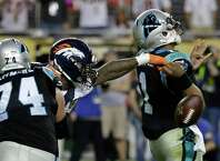 Denver Broncos' Von Miller (58) strips the ball from Carolina Panthers' Cam Newton (1) during the second half of the NFL Super Bowl 50 football game Sunday, Feb. 7, 2016, in Santa Clara, Calif. (AP Photo/Marcio Jose Sanchez)  ORG XMIT: NFL536