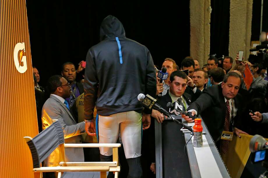 Cam Newton exits the post-game press conference. Photo: Kevin C. Cox, Getty Images