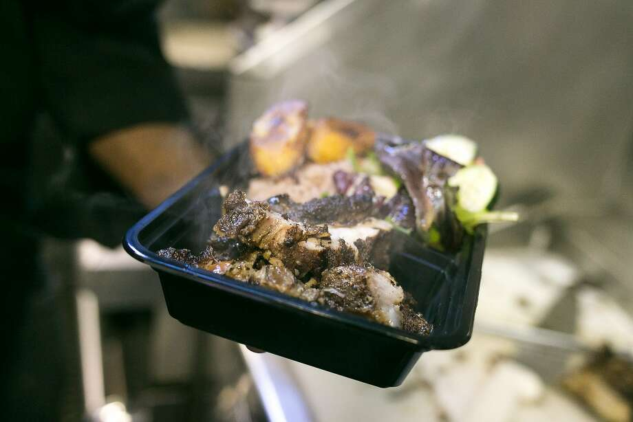 A plate of jerk pork from Scotch Bonnet. Photo: Jen Fedrizzi, Special To The Chronicle