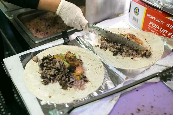 Two burritos are stuffed with pork, vegetables and plantains at Scotch Bonnet.