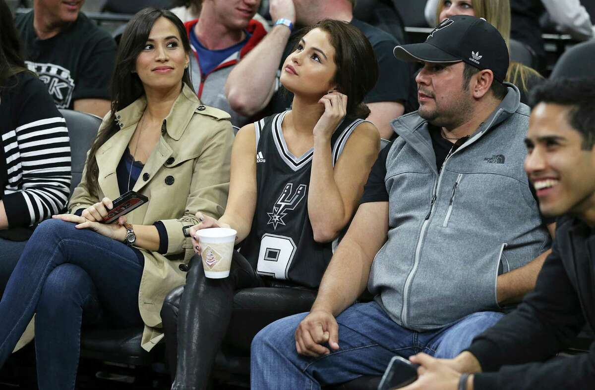 Selena Gomez sits with Tony Parker's wife as the Spurs host the Lakers at the AT&T Center on February 6, 2016.