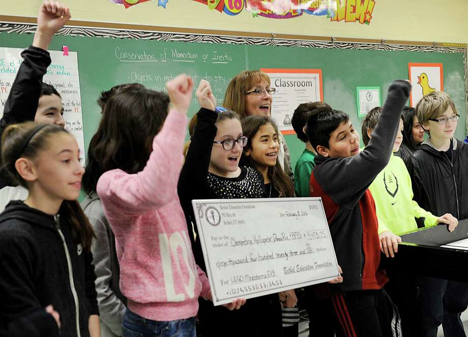 Clementine Hollopeter, center, a Bethel Middle School teacher, celebrates with some of her students after being presented with a check $9,473.75 from the Bethel Education Foundation. The Foundation visited three schools Monday morning, Feb. 8, 2016, to deliver more than $30,000 in Grants. Photo: Carol Kaliff, Hearst Connecticut Media / The News-Times
