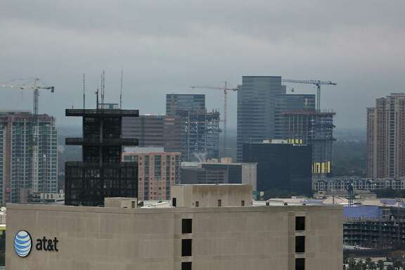 Construction cranes dot the skyline near the Galleria area Tuesday, Jan. 13, 2015, in Houston. ( James Nielsen / Houston Chronicle )