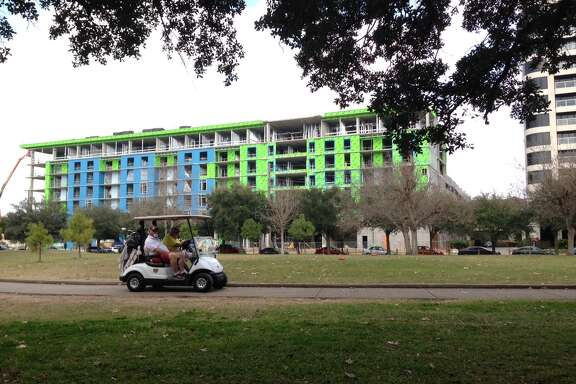 An apartment building under construction at 1699 Hermann Drive across from Hermann Park.
