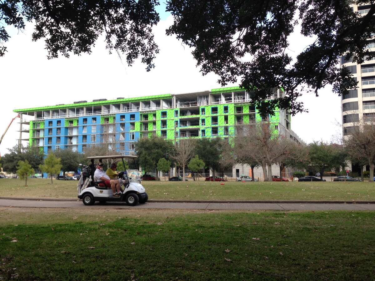 An apartment building under construction at 1699 Hermann Drive across from Hermann Park. Continue clicking to see the buildings that shaped the Houston skyline.