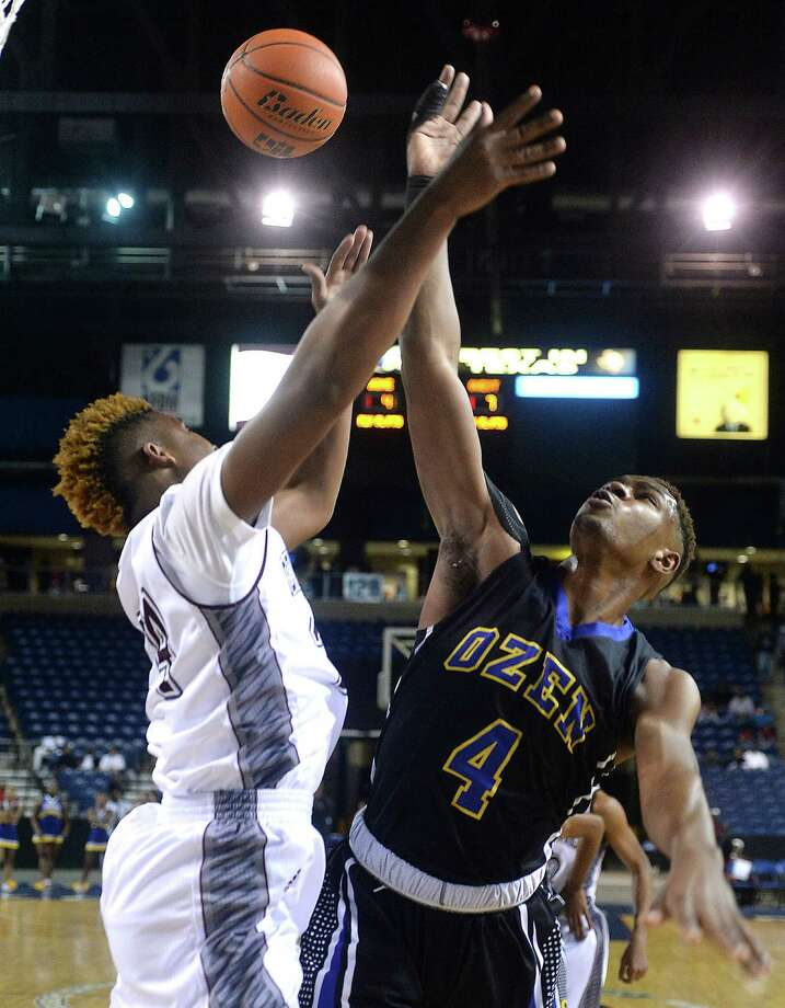 Central's Delvin Bennett and Ozen's Travon Gipson battle for control of the rebound during Friday night's double-header rematch at Ford Park Arena. Photo taken Friday, February 5, 2016 Kim Brent/The Enterprise Photo: Kim Brent / Beaumont Enterprise