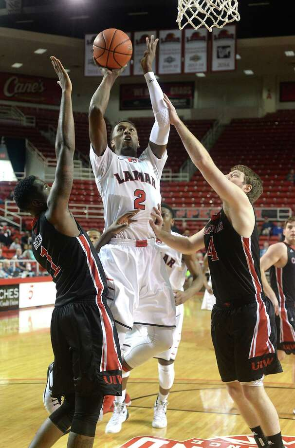 Lamar's Doprian Chatman gets in-between Incarnate Word's Derail Green and Kyle Hittle for the basket during Saturday's double-header match-up at the Montagne Center. Photo taken Saturday, February 6, 2016 Kim Brent/The Enterprise Photo: Kim Brent / Beaumont Enterprise