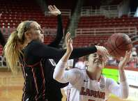 Lamar's Baileigh O'Dell goes after the loose ball after it is knocked away by Incarnate Word's Quincy Baker during Saturday's double-header match-up at the Montagne Center. Photo taken Saturday, February 6, 2016 Kim Brent/The Enterprise