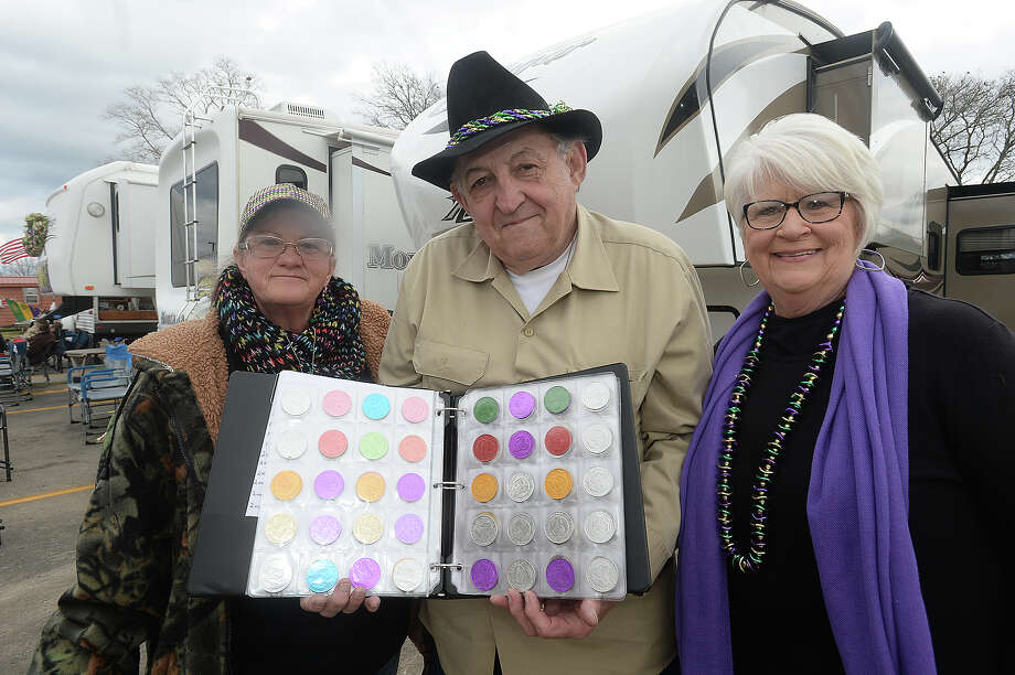 Terry Oliver of Nederland, seen here with friend Linda Redding (left) and wife Pat, has been collecting doubloons from Mardi Gras of Southeast Texas in Port Arthur since the parade began in 1993. He and friends have met up at the same lot at Procter and Mobile every year and say the annual get-together has become like a family reunion. Photo taken Saturday, February 6, 2016 Kim Brent/The Enterprise Photo: Kim Brent / Beaumont Enterprise