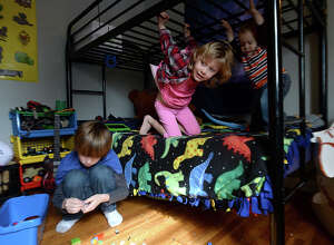 """Charlie Mullin, 8, and siblings Mirren, 5, and Spencer, 1, play in his room at their family home north of Beaumont. After kindergarten, Heather Mullin decided to home school her son, who was often bored with repetitive lessons and activities in the classroom. He is now """"unschooled,"""" and is an integral part of structuring his own learning activities and interests. Plans to create an alternative school based on the self-directed learning methodology is in the works among like minded parents in the area.  Photo taken Wednesday, January 27, 2016  Kim Brent/The Enterprise"""