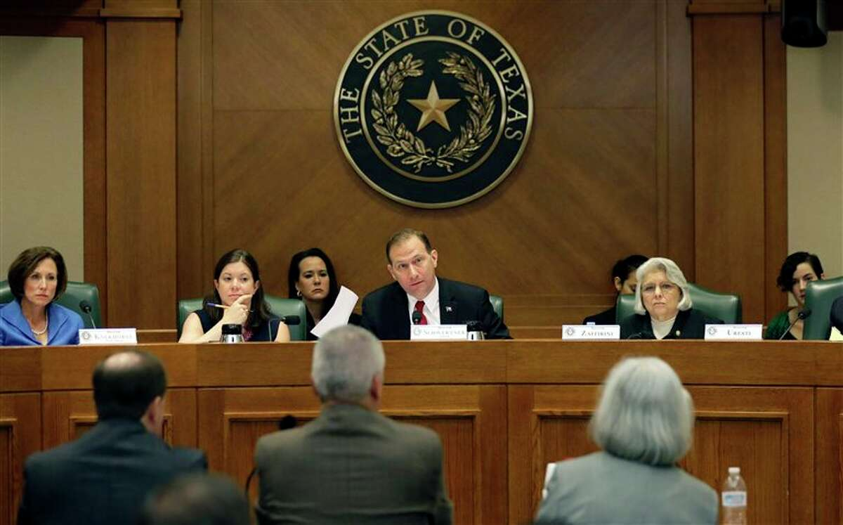 FILE - In this July 29, 2015, photo, Sen. Charles Schwertner, R-Georgetown, center, questions witnesses during a Texas Senate Health and Human Services Committee hearing on Planned Parenthood videos covertly recorded that target the abortion provider in Austin, Texas. Texas announced Monday, Oct. 19, 2015, that it was cutting off Medicaid funding to Planned Parenthood clinics following undercover videos of officials discussing fetal tissue, potentially triggering a legal fight like the one unfolding in neighboring Louisiana. (AP Photo/Eric Gay, File)