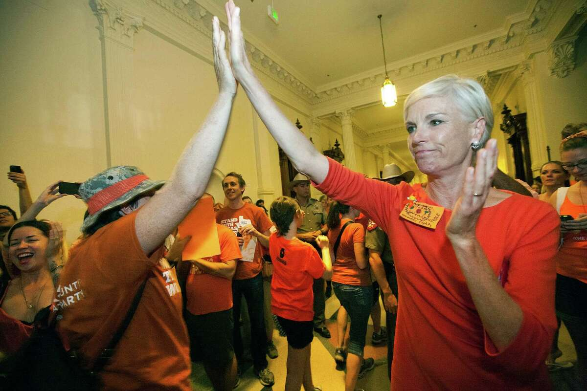 """FILE - In this July 12, 2013 file photo, Cecile Richards, daughter of former Texas Gov. Ann Richards and president of the Planned Parenthood Federation of America, greets abortion rights advocates as they leave the State Capitol rotunda in Austin, Texas. Abortions have declined in states where new laws make it harder to have them - but they?'ve also waned in states where abortion rights are protected, an Associated Press survey finds. Nearly everywhere, in red states and blue, abortions are down since 2010. """"Better access to birth control and sex education are the biggest factors in reducing unintended pregnancies,"""" said Richards. (AP Photo/Tamir Kalifa, File)"""