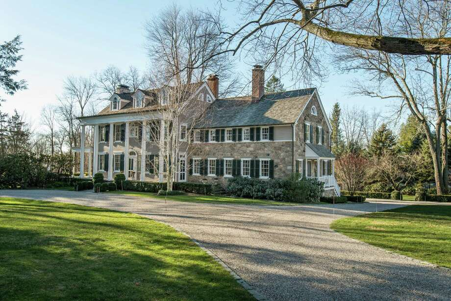 The current owners of this 19th century Colonial on Canoe Hill Road in New Canaan spent 15 years restoring it. Photo: Contributed Photos / New Canaan News