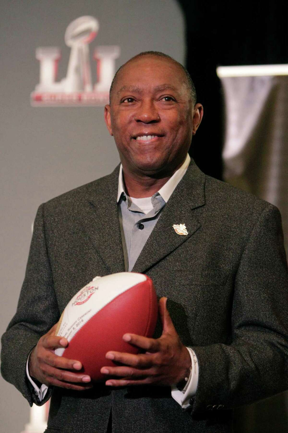 Mayor Sylvester Turner of Houston holds a football during a press conference where the Super Bowl LI committee took the Super Bowl handoff from San Francisco on Monday, February 8, 2016 in San Francisco, Calif.