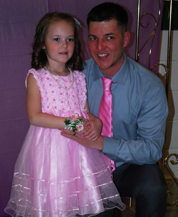Spirits were high at the annual Girl Scout Sweetheart Dance, sponsored Feb. 6 by New Milford Girl Scout Troop 40464 at New Milford High School. Above, Eddie Burns and his daughter, Kamryn, 5, pause for a keepsake photo to be taken at the start of the evening's festivities. Feb. 6, 2016. Photo: Deborah Rose / The News-Times