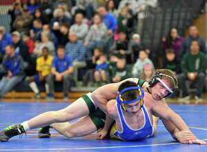 New Milford's CJ Schultz, top, and Newtown's Anthony Piazza wrestle in a 138-pound match at the New Fairfield Duals Saturday at New Fairfield High School.
